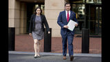 Attorney General for the Eastern District of Virginia G. Zachary Terwilliger, right, accompanied by Assistant United States Attorney Danya Atiyeh, left, arrives to announce the arrest of Henry Kyle Frese, a Defense Intelligence Agency official charged with leaking classified information to two journalists, including one he was dating, during a news conference outside the federal courthouse in Alexandria, Va., Wednesday, Oct. 9, 2019. (AP Photo/Andrew Harnik)
