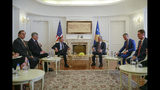 Kosovo's president Hashim Thaci, right, meets with President Donald Trump's envoy for the Kosovo-Serbia dialogue, Ambassador Richard Grenell in Kosovo capital Pristina on Wednesday, Oct. 9, 2019. (AP Photo/Visar Kryeziu)