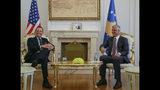 Kosovo's president Hashim Thaci, right, meets with President Donald Trump's envoy for the Kosovo-Serbia dialogue, Ambassador Richard Grenell in Kosovo capital Pristina on Wednesday, Oct. 9, 2019. (AP Photo/Visar Kryeziu)