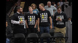"Activists wear ""Free Hong Kong"" T-shirts before an NBA exhibition basketball game between the Washington Wizards and the Guangzhou Loong-Lions, Wednesday, Oct. 9, 2019, in Washington. (AP Photo/Nick Wass)"