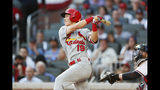 St. Louis Cardinals' Tommy Edman triples during the second inning of Game 5 of their National League Division Series baseball game against the Atlanta Braves, Wednesday, Oct. 9, 2019, in Atlanta. (AP Photo/John Bazemore)