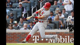 St. Louis Cardinals' Tommy Edman doubles to score teammates Marcell Ozuna and Yadier Molina during the first inning of Game 5 of their National League Division Series baseball game against the Atlanta Braves, Wednesday, Oct. 9, 2019, in Atlanta. (AP Photo/John Bazemore)