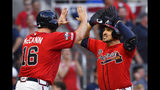 Atlanta Braves Adam Duvall (23) is congratulated by Atlanta Braves Brian McCann (16) after Duvall's two-run homer against the St. Louis Cardinals in the seventh inning during Game 2 of a best-of-five National League Division Series, Friday, Oct. 4, 2019, in Atlanta. (AP Photo/John Amis)