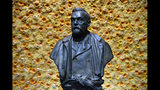 FILE - In this Monday, Dec. 10, 2018 file photo, a bust of the Nobel Prize founder, Alfred Nobel on display at the Concert Hall during the Nobel Prize award ceremony in Stockholm. Controversy stalks the Nobel prizes for peace and literature in a way it rarely does for science. The revamped panel at the Swedish Academy who will hand out the Nobel literature prizes Thursday Oct. 10, 2019, for both 2018 and 2019 would relish arguments about the winners, rather than intrigue about the #MeToo scandal that forced the institution to suspend the prize last year. (Henrik Montgomery/Pool Photo via AP, File)