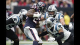 Houston Texans running back Carlos Hyde (23) is stopped by Carolina Panthers defenders Brian Burns (53), Luke Kuechly (59) and Javien Elliott, right, during the first half of an NFL football game Sunday, Sept. 29, 2019, in Houston. (AP Photo/Michael Wyke)