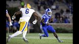 Duke's Quentin Harris (18) carries the ball as Pittsburgh's John Morgan (6) chases during an NCAA college football game in Durham, N.C., Saturday, Oct. 5, 2019. (AP Photo/Ben McKeown)