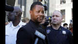 "FILE - In this June 26, 2019, file photo, actor Cuba Gooding Jr. leaves criminal court in New York. Gooding's New York trial on groping charges is scheduled to begin Thursday, Oct. 10, after it was postponed in September after prosecutors said they were still waiting for evidence in the Oscar-winning ""Jerry Maguire"" star's case. He's pleaded not guilty to forcible touching and sexual abuse charges. (AP Photo/Richard Drew, File)"
