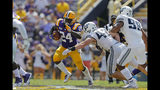 LSU running back Chris Curry (24) carries against Utah State defensive end Nick Heninger (42) in the second half of an NCAA college football game in Baton Rouge, La., Saturday, Oct. 5, 2019. (AP Photo/Gerald Herbert)
