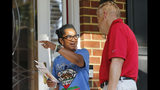 Virginia House of Delegates Speaker, Kirk Cox, R-Colonial Heights, talks with resident Sharon Brooks as he canvasses a neighborhood in Petersburg, Va., Monday, Sept. 23, 2019. Cox is facing Democratic challenger Shelia Bynum-Coleman in the November election. (AP Photo/Steve Helber)