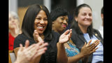 Democratic candidate for the 66th district of the Virginia House of Delegates, Shelia Bynum-Coleman, applauds speakers during a meeting of the Liberal Women of Chesterfield County in Chesterfield, Va., Wednesday, Sept. 25, 2019. Bynum-Coleman is facing House Speaker Kirk Cox in the November election. (AP Photo/Steve Helber)
