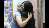Democratic candidate for the 66th district of the Virginia House of Delegates, Shelia Bynum-Coleman, gets a hug from supporter from Kim Drew Wright, left, at a meeting of the Liberal Women of Chesterfield County in Chesterfield, Va., Wednesday, Sept. 25, 2019. Bynum-Coleman is facing House Speaker Kirk Cox in the November election. (AP Photo/Steve Helber)