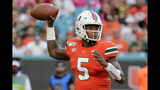 Miami quarterback N'Kosi Perry (5) stands back to pass during the first half of an NCAA college football game against Virginia, Saturday, Oct. 5, 2019, in Miami Gardens, Fla. (AP Photo/Lynne Sladky)