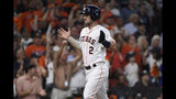 Houston Astros third baseman Alex Bregman (2) scores against the Tampa Bay Rays during the first inning of Game 5 of a baseball American League Division Series in Houston, Thursday, Oct. 10, 2019. (AP Photo/Eric Christian Smith)
