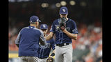 Tampa Bay Rays starting pitcher Tyler Glasnow, right, is pulled during the third inning of Game 5 of the baseball team's American League Division Series against the Houston Astros in Houston, Thursday, Oct. 10, 2019. (AP Photo/Michael Wyke)