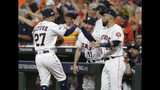 Houston Astros second baseman Jose Altuve (27) celebrates with teammate Robinson Chirinos (28) after he turned a double play against the Tampa Bay Rays in the seventh inning of Game 5 of a baseball American League Division Series in Houston, Thursday, Oct. 10, 2019. (AP Photo/Michael Wyke)