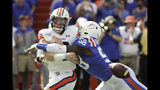 Auburn quarterback Bo Nix, left, is hit by Florida linebacker Jonathan Greenard (58) as he releases the ball during the first half of an NCAA college football game, Saturday, Oct. 5, 2019, in Gainesville, Fla. (AP Photo/John Raoux)