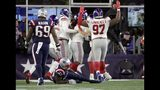 New England Patriots wide receiver Josh Gordon lies injured on the turf after trying to tackle New York Giants linebacker Markus Golden who recovered a fumble for a touchdown in the first half of an NFL football game, Thursday, Oct. 10, 2019, in Foxborough, Mass. (AP Photo/Elise Amendola)