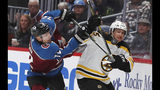 Colorado Avalanche right wing Joonas Donskoi, left, works against Boston Bruins defenseman Connor Clifton during the third period of an NHL hockey game Thursday, Oct. 10, 2019, in Denver. Colorado won 4-2. (AP Photo/David Zalubowski)