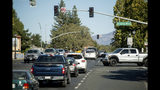Vehicles backs up on Highway 12 as traffic signals remain dark during a power outage on Wednesday, Oct. 9, 2019, in Boyes Hot Springs, Calif. Pacific Gas and Electric has cut power to more than half a million customers in Northern California hoping to prevent wildfires during dry, windy weather throughout the region. (AP Photo/Noah Berger)
