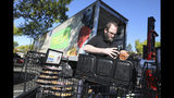 Jamie Olivas transfers items from a Safeway store on Calistoga Road into a refrigerated trailer in order to keep them cold during a power outage in Santa Rosa, Calif., Wednesday, Oct. 9, 2019. Pacific Gas & Electric has cut power to more than half a million customers in Northern California hoping to prevent wildfires during dry, windy weather throughout the region. (Christopher Chung/The Press Democrat via AP)