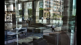 FILE - In this Aug. 27, 2018, file photo downtown Los Angeles buildings and office workers are reflected in the front windows of a building. California has proposed rules for companies preparing for the state's data privacy bill, including setting out specific ways people can ask for their personal information to be deleted from company databases. (AP Photo/Richard Vogel, File)