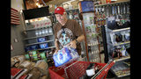 James Cooke is shown buying water bottles along with propane tanks and batteries at a ACE Hardware store as he prepares for a possible power shutdown in Los Gatos, Calif., on Tuesday, Oct. 8, 2019. Millions of people were poised to lose electricity throughout northern and central California after Pacific Gas & Electric Co. announced Tuesday it would shut off power in the largest preventive outage in state history to try to avert wildfires caused by faulty lines. (Anda Chu/San Jose Mercury News via AP)