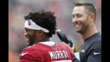 Arizona Cardinals quarterback Kyler Murray, left, speaks with head coach Kliff Kingsbury, right, in the first half of an NFL football game against the Cincinnati Bengals, Sunday, Oct. 6, 2019, in Cincinnati. (AP Photo/Gary Landers)