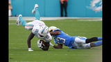 Los Angeles Chargers cornerback Michael Davis (43) tackles Miami Dolphins wide receiver Preston Williams (18) to the ground, during the second half at an NFL football game, Sunday, Sept. 29, 2019, in Miami Gardens, Fla. (AP Photo/Wilfredo Lee)