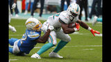 Los Angeles Chargers defensive end Melvin Ingram (54) tackles Miami Dolphins running back Mark Walton (22), during the first half at an NFL football game, Sunday, Sept. 29, 2019, in Miami Gardens, Fla. AP Photo/Wilfredo Lee)