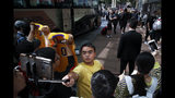 Fans take smartphone selfies and show off their LA Lakers jerseys as NBA players step out from a bus outside the Ritz-Carlton hotel in Shanghai, China, Thursday, Oct. 10, 2019. NBA Commissioner Adam Silver told the Brooklyn Nets and Los Angeles Lakers on Wednesday that the league is still expecting them to play as scheduled this week, even while the rift between the league and Chinese officials continued in ways that clearly suggested the two planned games in Shanghai and Shenzhen were anything but guaranteed. (AP Photo/Andy Wong)