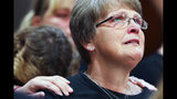 """Kristine Young, mother of Ashley Young, reacts at the sentencing of Jared Chance in Kent County Circuit Court, Thursday, Oct. 10, 2019, in Grand Rapids, Mich. Chance, a Michigan man convicted of killing and dismembering Ashley Young has been sentenced to at least 100 years in prison after a judge called his actions """"reprehensible and heinous.""""(Brian Hayes/The Grand Rapids Press via AP)"""