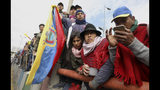 Indigenous people welcome their comrades during a protest in Quito, Ecuador, Thursday, Oct. 10, 2019. Protests started last week after Ecuador's President Lenin Moreno ended fuel subsidies, leading to price increases. The disturbances have spread from transport workers to students and then to indigenous demonstrators. (AP Photo/Fernando Vergara)