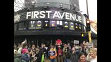 Opponents of President Donald Trump protest ahead of his rally at Target Center on Thursday, Oct. 10, 2019. They're standing across the street in front of the landmark First Avenue nightclub, which put rainbow decals on its windows that spelled out VOTE 2020. (AP Photo/Steve Karnowski)