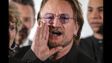 Irish rock band U2 singer Bono shouts during a family picture in Lyon, central France, Wednesday Oct. 9, 2019, before the funding conference of Global Fund to Fight AIDS, Tuberculosis and Malaria. (Ludovic Marin, Pool via AP)