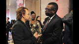 Senegalese singer Youssou N'dour, right, speaks with Irish rock band U2 singer Bono at the City Hall of Lyon, central France, Wednesday Oct.9 2019, ahead of the two-day conference of Global Fund to Fight HIV, Tuberculosis and Malaria. (Olivier Chassignole, Pool via AP)