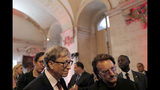US Microsoft founder, Co-Chairman of the Bill & Melinda Gates Foundation, Bill Gates, left, and Irish rock band U2 singer Bono arrive at the City Hall of Lyon, central France, Wednesday Oct.9 2019, ahead of the two-day conference of Global Fund to Fight HIV, Tuberculosis and Malaria. (Olivier Chassignole, Pool via AP)