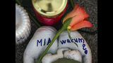 FILE -- In this Dec. 28, 2017 photo a sculpture with the Name 'Mia' and the word 'Why?' written on it is pictured in Kandel, Germany. German prosecutors say an Afghan migrant who was convicted of murdering his 15-year-old German girlfriend has been found dead in his cell after apparently hanging himself. (Andreas Arnold/dpa via AP, file)