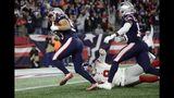 New England Patriots defensive end Chase Winovich, left, carries the ball to the end zone for a touchdown after a punt by New York Giants punter Riley Dixon, on the turf, was blocked in the first half of an NFL football game, Thursday, Oct. 10, 2019, in Foxborough, Mass. (AP Photo/Elise Amendola)