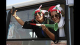 Iranian women cheer as they arrive to the Azadi Stadium to watch the 2022 World Cup qualifier soccer match between Iran and Cambodia, in Tehran, Iran, Thursday, Oct. 10, 2019. Iranian women were freely allowed into the stadium for the first time in decades. They had been banned since 1981. (AP Photo/Vahid Salemi)