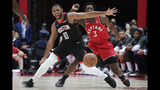 Houston Rockets' Eric Gordon, front, goes after a loose ball under defense by Toronto Raptors' OG Anunoby during the first half of an NBA preseason basketball game Thursday, Oct. 10, 2019, in Saitama, near Tokyo. (AP Photo/Jae C. Hong)