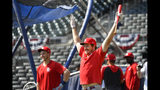 St. Louis Cardinals starting pitcher Miles Mikolas (39) reacts during a baseball team workout Wednesday, Oct. 2, 2019, at SunTrust Park in Atlanta. The Braves will host the St. Louis Cardinals in the first game of a National League Division Series on Thursday. (AP Photo/John Amis)