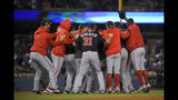 Washington Nationals celebrate after their 7-3 win in Game 5 of the baseball team's National League Division Series against the Los Angeles Dodgers on Wednesday, Oct. 9, 2019, in Los Angeles. (AP Photo/Mark J. Terrill)