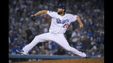 Los Angeles Dodgers pitcher Clayton Kershaw throws to a Washington Nationals batter during the seventh inning in Game 5 of a baseball National League Division Series on Wednesday, Oct. 9, 2019, in Los Angeles. (AP Photo/Mark J. Terrill)