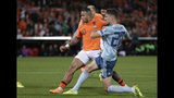 Netherlands' Memphis Depay, left, scores his side's first goal during the Euro 2020 group C qualifying soccer match between The Netherlands and Northern Ireland at De Kuip stadium in Rotterdam, Netherlands, Thursday, Oct. 10, 2019. (AP Photo/Peter Dejong)