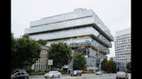 FILE - In this Sept. 12, 2019, file photo, cars pass Purdue Pharma headquarters in Stamford, Conn. How much members of the Sackler family should be held accountable for the role their company, Purdue Pharma, played in the nation's opioid crisis will be at the center of a hearing in federal bankruptcy court. State attorneys general who are pressing separate state claims against the Sacklers want their cases to continue even as Purdue's bankruptcy case plays out. They will make that argument on Friday, Oct. 11, 2019 before a bankruptcy judge in White Plains, New York. (AP Photo/Frank Franklin II, File)