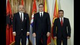 In this photo provided by the Serbian Presidential Press Service, Serbian President Aleksandar Vucic, center, poses for photographers with Albania's Prime Minister Edi Rama, left, and North Macedonia's Prime Minister Zoran Zaev prior to the start of the meeting in Novi Sad, Serbia, Thursday, Oct. 10, 2019. Prime Ministers of North Macedonia and Albania are visiting Serbia to discuss removing trade barriers. (Serbian Presidential Press Service via AP)