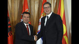 In this photo provided by the Serbian Presidential Press Service, Serbian President Aleksandar Vucic, right, shakes hands with North Macedonia's Prime Minister Zoran Zaev prior to the start of the meeting in Novi Sad, Serbia, Thursday, Oct. 10, 2019. Prime Ministers of North Macedonia and Albania are visiting Serbia to discuss removing trade barriers. (Serbian Presidential Press Service via AP)
