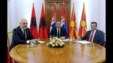 In this photo provided by the Serbian Presidential Press Service, Serbian President Aleksandar Vucic, center, speaks with Albania's Prime Minister Edi Rama, left, and North Macedonia's Prime Minister Zoran Zaev during the meeting in Novi Sad, Serbia, Thursday, Oct. 10, 2019. Prime Ministers of North Macedonia and Albania are visiting Serbia to discuss removing trade barriers. (Serbian Presidential Press Service via AP)