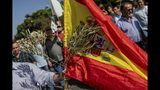 Olive farmers protest in Madrid, Thursday, Oct. 10, 2019. Thousands of farmers rallied in Spain's capital to protest against low prices and demand government protection against US plans to levy taxes on EU agricultural produce. (AP Photo/Bernat Armangue)