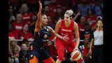 Washington Mystics forward Elena Delle Donne, right, drives against Connecticut Sun forward Alyssa Thomas during the first half of Game 5 of basketball's WNBA Finals, Thursday, Oct. 10, 2019, in Washington. (AP Photo/Alex Brandon)